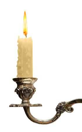 burning old candle vintage bronze Silver candlestick. Isolated On White Background.