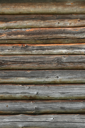 Wooden wall from logs old as background texture Imagens