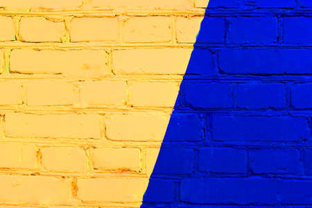 Abstract yellow brick wall texture depicting in paint colors on an old brick wall. Reklamní fotografie