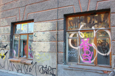 the facade of the historic building was painted with vandals and trash was thrown