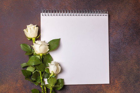one sheet: White notepad on a brown background