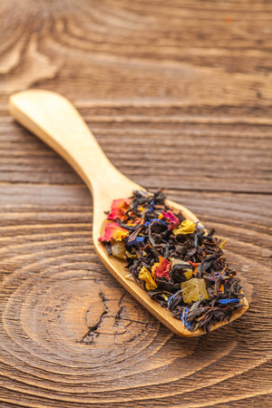 loose leaf: black tea with fruit on a wooden background