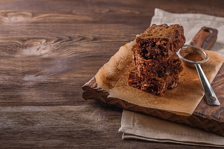 Brownie on a dark wooden background Stock Photo