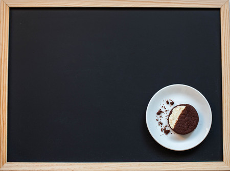 Oreo cookies on a black background with coffee