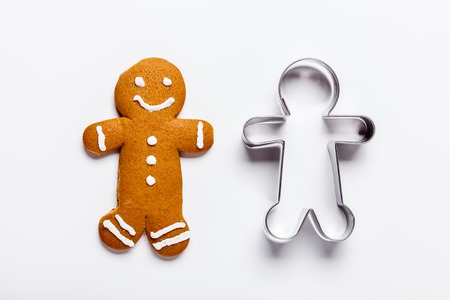 Christmas, New Year gingerbread man on a white background, horizontal, flat lay Stok Fotoğraf