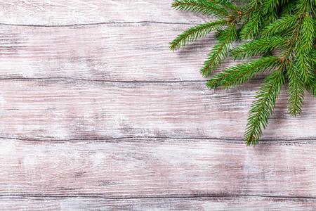 green fir branches on a light wooden background, horizontal, new Year, copyspace Stok Fotoğraf