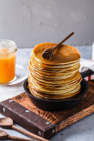 Pancakes with honey on a gray background, horizontally, copyspace, vertically Stock Photo