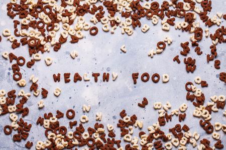 Dry breakfast, granola, muesli on a gray background horizontal top view copyspace flat lay