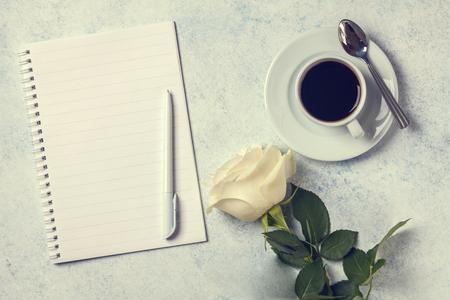 White roses, notebook on a gray background, copyspace, horizontal Stok Fotoğraf