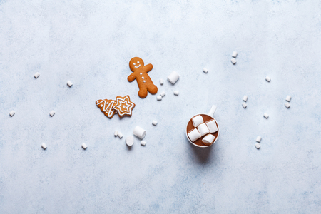 Christmas ginger cookies on a gray-blue background, horizontal, new Year, flat lay, copyspace, hands in mittens