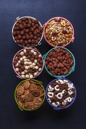 Dry breakfast, granola, muesli on a black background vertically top view copyspace flat lay Stok Fotoğraf