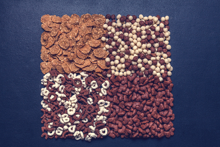 Dry breakfast, granola, muesli on a black background horizontal top view copyspace flat lay