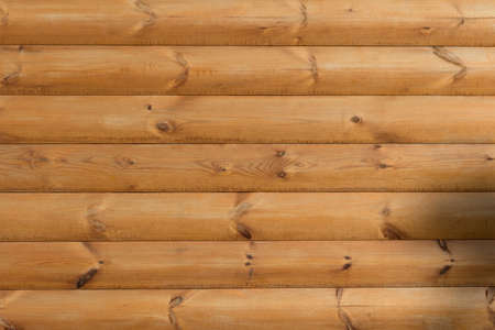 Texture of a brown plank wooden wall. Perfect background for you site