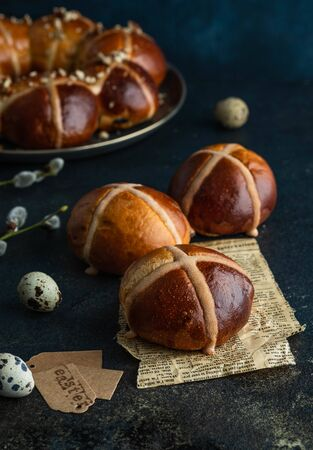 Traditional Easter cross buns on easter background.