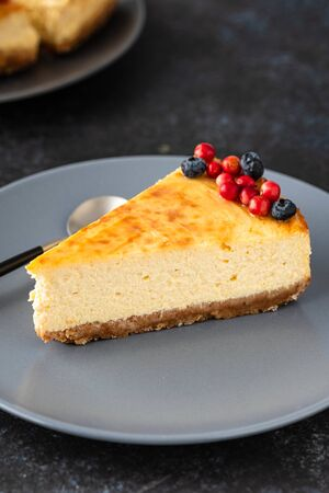Slice of cheesecake with berries on a plate. Stok Fotoğraf