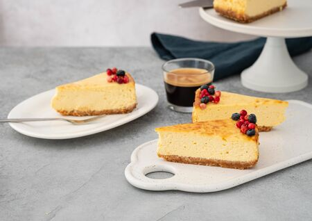 Sliced cheesecake with a glass of coffee. Copy space.