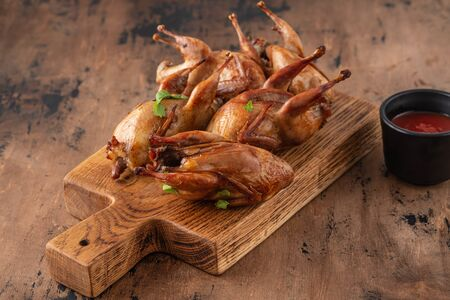Delicious fried roasted quails with herbs, spices and beer.