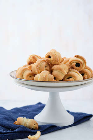 Homemade bagel cookies with marmalade inside. Sweet croissant cookies. Selective focus
