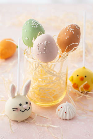 Delicious sweet cake pops on light background, closeup. Easter holiday.