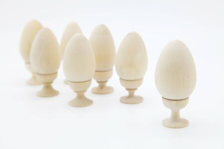 Decorative chicken eggs made of natural wood made by hand.The concept of the Christian Easter tradition is to creatively decorate and color artistically a bunch of eggs for a gift.