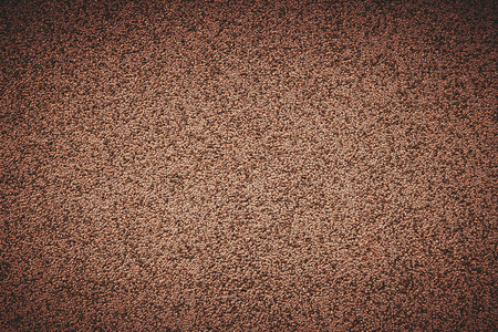 Textured granular. Texture of the plaster. The background. Decorative plaster on the surface of the house. Textures.