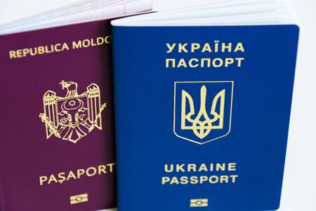 Friendship of nations: Ukrainian passport and the passport of Moldova close up on a white background Фото со стока