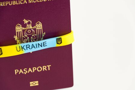 Friendship concept: Prapor Ukraine to Moldova passport closeup on a white background