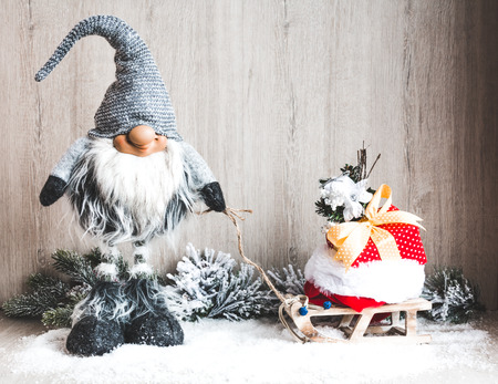 Christmas gnome with gifts on the sleigh. Christmas or New Year concept Фото со стока
