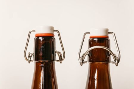 two empty Brown bottles with lids.