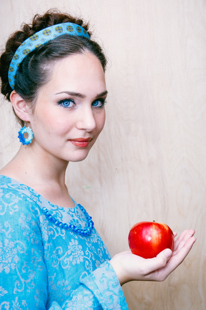girl in a blue dress with Apple in the Palm of your hand.