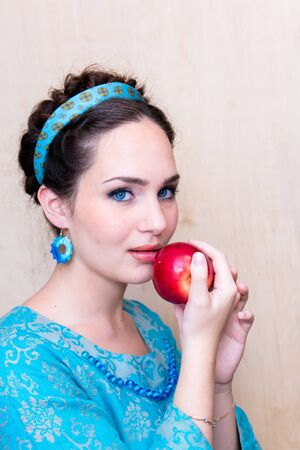 girl in a blue dress with Apple in the Palm of your hand