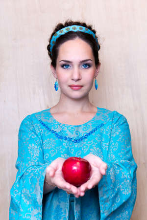 girl in a blue dress with Apple in the Palm of your hands.