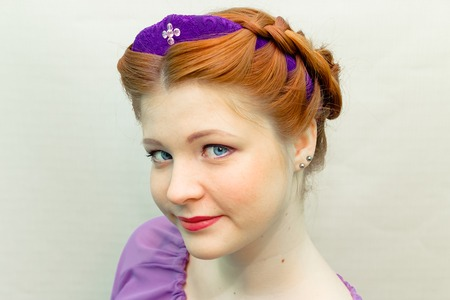 girl with a hair style in a Slavic style.
