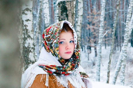 girl - Slavic appearance wrapped in a scarf in winter.