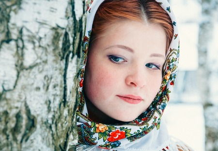 girl in a headscarf at the birches. Stock Photo