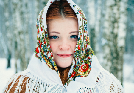 girl in Slavic style. a girl in a scarf.