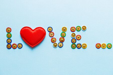 the word love collection of stationery multicolored buttons Stock Photo
