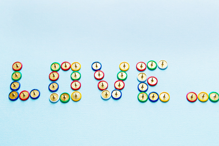 word love from pins collection of stationery multicolored buttons, love theme.