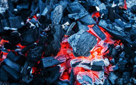 red-hot charcoals prepared for a barbecue, close up background