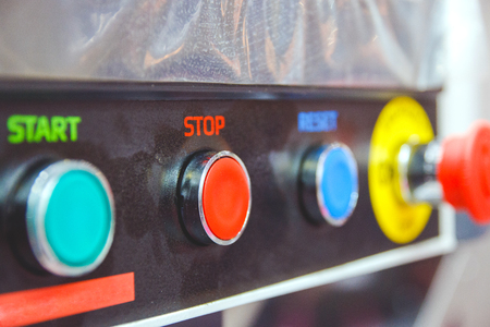 buttons for switching on and off the industrial electrical equipment.