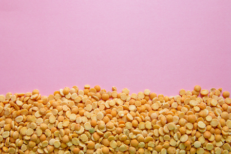 stab peas on pink background with copy space at the top for lettering. Stock Photo
