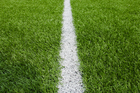 Green Football background with a vertical line. 写真素材