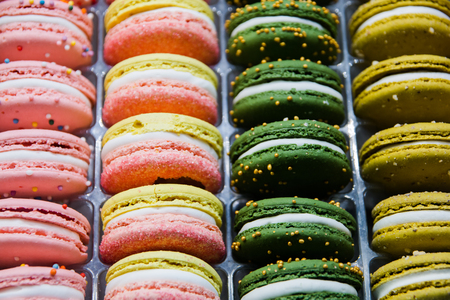Bright beautiful macaroons with tender and flavorful cream. The contrast of colors and the ideal form, selective focus.