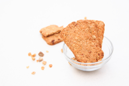 blurred muesli cookies isolated on white background, selective focus. Top view.
