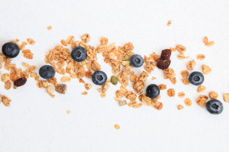 Crunchy muesli and blueberry Breakfast cereals isolated on white background, selective focus, top view.