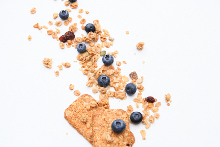 Crispy muesli cookies and blueberry Breakfast cereals isolated on white background, selective focus, top view. Archivio Fotografico
