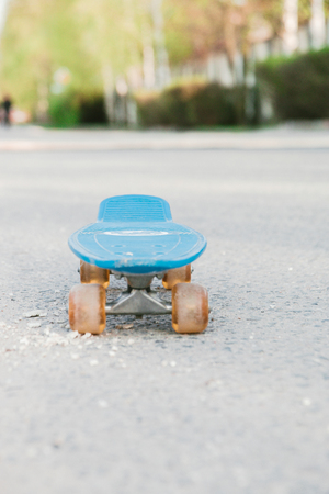 blue childrens skateboard in the Park on a Sunny summer day. 写真素材