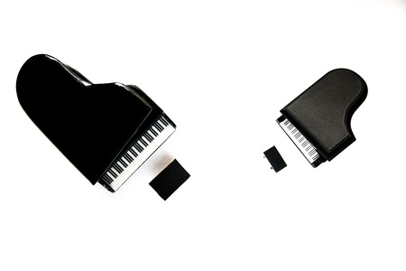 miniature classic keyboard instruments large and small piano isolated on white background. 写真素材
