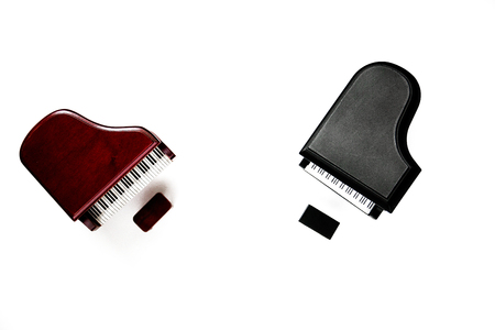 miniature classic piano keyboard instruments isolated on white background.