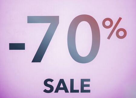 Seasonal discounts in stores, sale, Black Friday and shopping concept. discount 70 percent discount in the shop window.